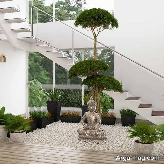 دیزاین مدرن زیر راه پله با گل های طبیعی