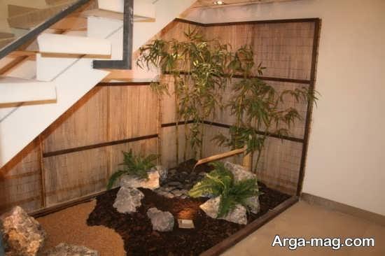دیزاین هنرمندانه زیر راه پله با گل های طبیعی