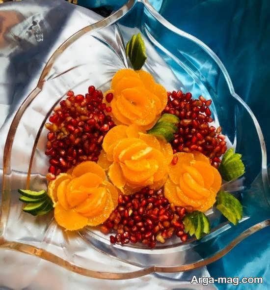 دیزاین میوه به شکل گل هایی زیبا با نارنگی