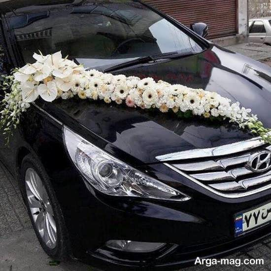 تزیین خودروی ماشین عروس با گل های سفید