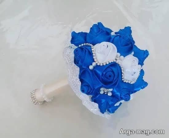 گالری شیکی از تزیینات دسته گل عروس با رنگ بای و سفید